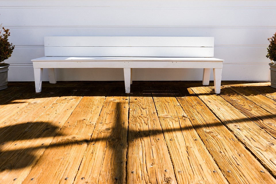 A bench on decking outside